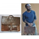 Sacoche vintage avec boucle de fixation par Abas Koanda